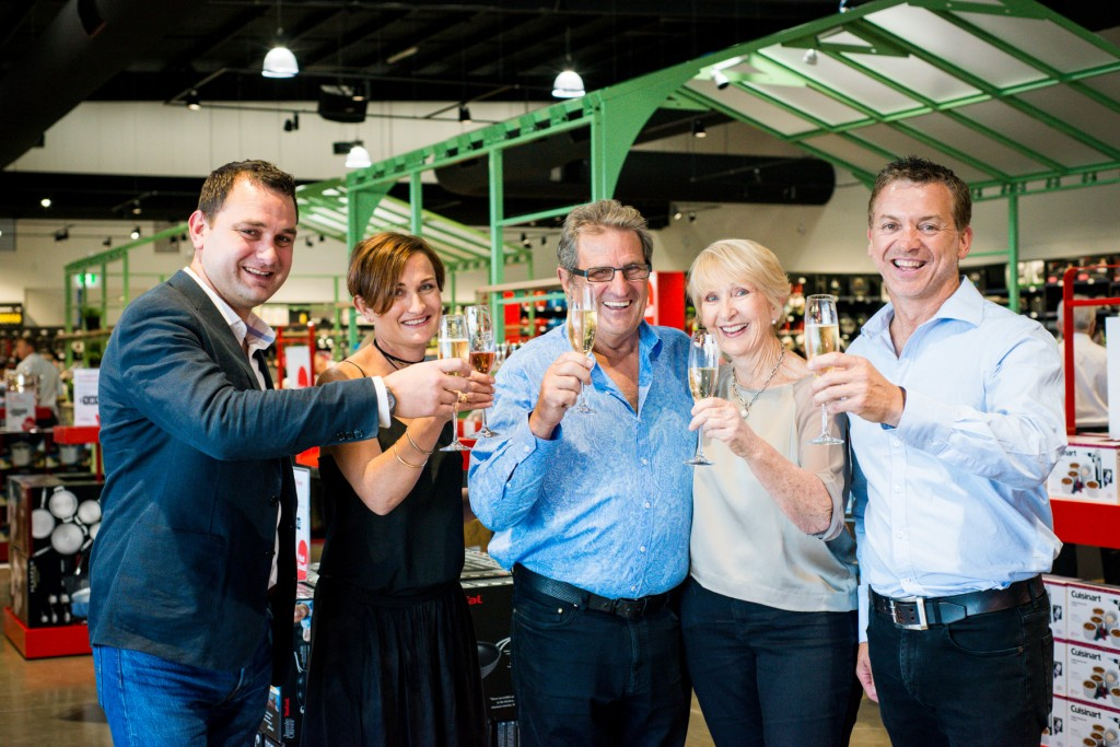 Peter Macaulay, Justine Murphy, John Macaulay, Marilyn Macaulay, and Chris Murphy toasting the opening of the first Kitchen Warehouse store over east in Preston, Victoria.