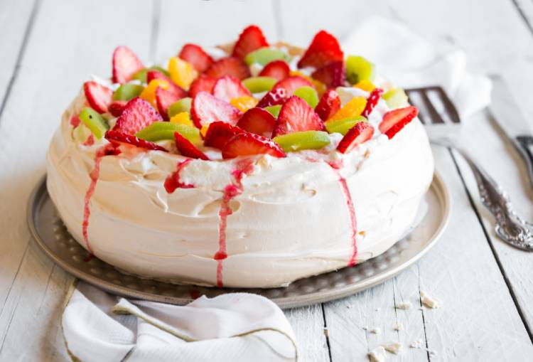 Pavlova with Fresh Strawberries, Peach, and Kiwi