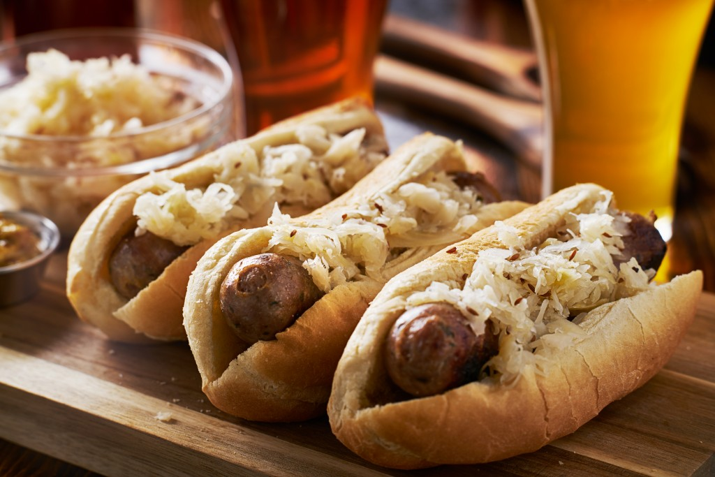 Classic German sausages topped with sauerkraut and paired with beer